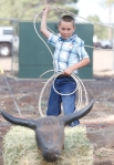 Lukas Palmitier, 8, works on his lasso skills during the Flagstaff Pro Rodeo Thursday.