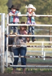 Young rodeo fans stand on a fence for a better view of the action at the Flagstaff Pro Rodeo Thursday.
