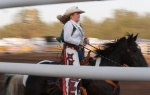 Andy Devine Days Rodeo Queen Haley Olsen rides through the arena during the Flagstaff Pro Rodeo Thursday.