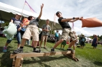 Caleb Lachowski, 9, left, is knocked off balance by Samuel Stuart, 13, right, while participating in a balance beam pillow fight at the Arizona Highland Celtic Festival Saturday.