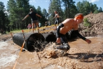 A participant in the Terrain Racing Mud Run Obstacle Race makes his way through one of many obstacles along the course at Fort Tuthill County Park Saturday. Runners could choose either a 5k or 10k course that features up to 20 obstacles ranging from mud pits and monkey bars to rope ladders and walls to climb.