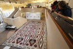Festival goers admire one of the world's largest Navajo rugs which was on display at the Museum of Northern Arizona during the 66th annual Navajo Festival of Arts and Culture Saturday. The rug, which measures 26-feet by 36-feet, was on loan to the museum from the Winslow Arts Trust.