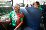 Ester Chavez rides a shuttle bus up the last leg of Snowbowl Road during the Climb to Conquer Cancer Saturday. Chavez has been participating in the annual event for the last 20 years and this is the first time she has taken advantage of a shuttle bus.
