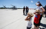 Charlee Kosterman, 4, left, and Sean Fuller, 5, right cover their ears as a US Marine Corps SuperCobra helicopter prepares to take off during the Thunder Over Flagstaff air show at Flagstaff's Pulliam Airport Saturday morning.