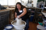Alma Angelina Aispuro spins a pot on a pottery wheel in her home studio during the 18th annual Flagstaff Open Studios Saturday afternoon. During the two day event, which continues Sunday, many area artists open their studios and homes to the public offering demonstrations and selling their art.
