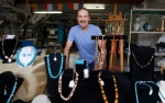 Local jewelry maker Billy Bob Vaughan stands with some of his creations at his home during the annual Flagstaff Open Studios Saturday.