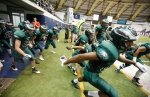 The Flagstaff High School Eagles take the field for their season opening game at the Walkup Skydome Friday night.