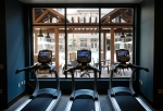 The Village at Aspen Place features a full gym with views of the common pool area which is open to residents.
