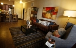 Inside the living room of a one-bedroom apartment at The Village at Aspen Place.
