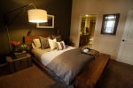 A view of the bedroom inside an apartment at the newly opened Village at Aspen Place in Flagstaff.