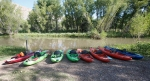 Kayaks sit at the edge of the Verde River before a paddle tour in August. Doug Von Gausig, the mayor of Clarkdale and director of the Verde River Institute, leads the kayak trips at least once a week to boost the profile of the river as an economic driver in the valley.