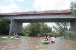 Kayakers paddle the Verde River under Tuzigoot Bridge near the town of Clarkdale. The town recently created two official river access points to promote recreation on the water.