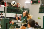Flagstaff High School's Courtney Leffel (1) spikes the ball over the net during game action against Prescott High Tuesday evening.