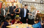 Arizona Governor Doug Ducey, center, visits a third-grade Navajo immersion class room at Puente de Hozho School with Principal Dawn Trubakoff, right, Wednesday afternoon.