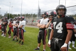 Members of the Coconino High School football team wait their turn while running drills at a recent practice.