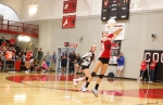 Coconino High School's Lauren Touchstone (10) hits the ball during Thursday night's game against Prescott High.
