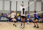 Northland Preparatory Academy's Myka Becenti (5) sets the ball for teammate McKael Barnes (9) to hit Thursday evening.