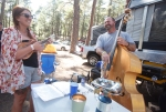 Rita Greenwell, left, plays a ukulele while Andy Shirk, right, plays his upright bass in the campground of the annual Pickin' in the Pines Bluegrass and Acoustic Music Festival. For many participants, the campground is a major highlight of the festival, with professional and amateur musicians playing impromptu sets together late into the evening.
