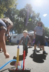 Marco Amabile, 4, stomps on a large foot pump, launching a paper rocket he made at The Wonder Factory's booth during Science in the Park Saturday afternoon.
