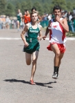 Davis Boggess of Flagstaff High School runs against a Mingus runner toward the finish at the Four Corners Cross Country Invitational Saturday. Boggess finished first for Flag High and sixth overall with a time of 16:53.4.