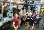 The newsroom staff of the Arizona Daily Sun standing near the onsite printing press. There should be two or three more, including myself, but not everyone could make it and someone had to take the photo.