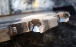 A detail shot of one tooth on the saw blade used by feller buncher's to harvest trees.
