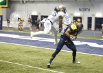 Northern Arizona University wide receiver Dejzon Walker (5) completes a pass on his way to a touchdown against Montana State Saturday.