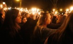 Mourners gathered at the Northern Arizona University campus for a candlelight vigil Friday night following a shooting that left one student dead and three others hospitalized earlier that day.