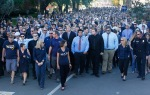 Several thousand people participated in a walk and gathering through the campus of Northern Arizona University in Flagstaff, Ariz. to honor the victims of Friday's deadly shooting.