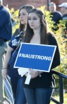 A student holds an NAU Strong sign during a walk and gathering Tuesday afternoon to honor the victims of Friday's deadly shooting on the campus of Northern Arizona University in Flagstaff, Ariz.
