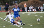Northland Preparatory Academy's Brianna Hovis (11) slides in front of a Chino Valley player during game action Thursday.