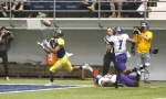 Northern Arizona University wide receiver Elijah Marks (3) catches the ball in the end zone for a touchdown against Weber State Saturday.