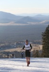 The first runner crests the top of the first climb at the Kahtoola Uphill race held at the Arizoan Snowbowl Saturday.