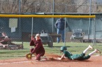 Flagstaff High School's Grace Meyer (9) slides into third base during Thursday's game against Winslow.