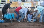 Tolman Moore of Las Cruces, N.M. is helped to his feet after being knocked unconcious when he was tossed from his horse during the bareback bronc riding competition at the Flagstaff Pro Rodeo Thursday evening.