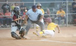 West Flag Little Leagues Nick Lopez slides into home during game action against Winslow Friday.