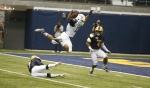 Northern Arizona University's Kendyl Taylor (13) flies over a Northern Colorado Player Friday.