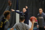 Northern Arizona University Head Coach Jack Murphy runs his players through drills during team practice Thursday afternoon.