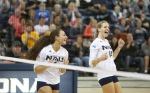 Northern Arizona University's Brittni Dorsey (4) and Addy Lofstedt (14) celebrate a score against Sacramento State Thursday night.