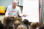 Gene Munger reads to fourth-graders at Knoles Elementary as part of the weekly Book Pals program.