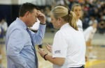 Northern Arizona University Head Coach Ken Murphy talks with an official after a point was recalled during Friday night's Big Sky Conference Championship semifinal game at Rolle Activity Center.