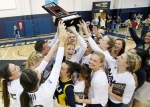 The Northern Arizona University volleyball team celebrates after beating Idaho State to win the Big Sky Conference Championship tournament Saturday night.