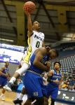 Northern Arizona University's Torry Johnson (0) jumps for a layup during Wednesday's game against Hampton University.