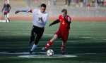Coconino High School's Hipolito Zavala (7) chases the ball alongside a Mingus player Thursday.