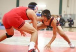 Casey Yazzie of Coconino High School squares off against a wrestler from Durango in the 132 pound weight class during the Peaks wrestling tournament Friday.