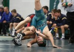 Bill Betoney of Flagstaff High School competes with a Lee Williams wrestler in the 182 pound weight class during the Peaks wrestling tournament at Flagstaff High School Friday.