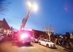 A Flagstaff fire department ladder truck arrives at Heritage Square in downtown Flagstaff to drop off Flagstaff Mayor Jerry Nabours along with Santa and Mrs. Claus to light the holiday tree Saturday evening.