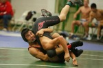 Isaac Cabrera of Coconino High School wrestles against an opponent from Page in the 120-pound weight class of the Peak wrestling tournament Saturday.