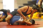 Coconino High School's Isaac Cabrera wrestles an opponent from Chino Valley Wednesday in the 120-pound weight class.