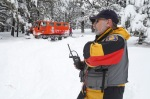 Coconino County Search and Rescue volunteer Art Pundt radios into headquarters after his snowcat was damaged by a large rock while on a routine mission in the forest below Arizona Snowbowl.